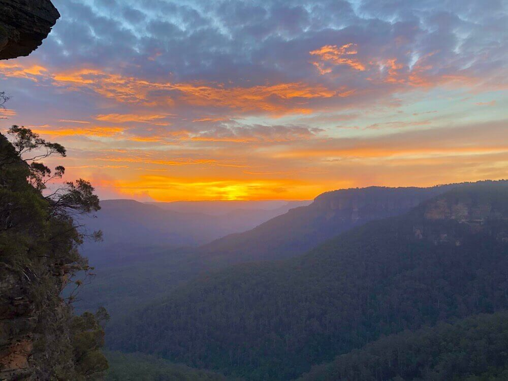 Blue Mountains National Park, New South Wales: A colourful sunset over the mountains.